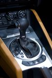 Gear stick in a car. Closeup of the gear stick in a car Royalty Free Stock Photos