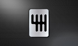 Gear Stick Shift Plate. A steel chrome gear stick shift plate on a carbon fibre surface Royalty Free Stock Photo