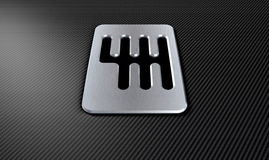 Gear Stick Shift Plate. A steel chrome gear stick shift plate on a carbon fibre surface Royalty Free Stock Photography