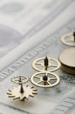 Gear of success. Gear wheels on dollar bill revealing the path to success Royalty Free Stock Photos