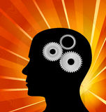 Gear symbol in the head of a thinking silhouette Stock Images
