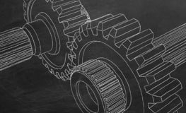 Gear transmission. Hand drawing on blackboard and animated gear transmission royalty free illustration