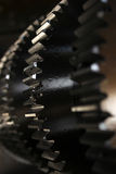 Gear wheel. Antique gear wheel echoed by an out of focus partner in the background Royalty Free Stock Photo