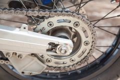 Gear wheel with chain of motorcycle wheel. Royalty Free Stock Photos