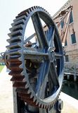 Gear wheel of a gear for lifting loads. Great gear wheel of a gear for lifting loads in the shipyard Stock Photo