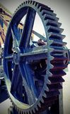 Gear wheel of a gear for lifting loads with vintage effect. Great gear wheel of a gear for lifting loads in the shipyard with vintage effect Royalty Free Stock Images