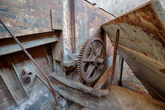 The gear wheel of a rusty old machine in brick factory Stock Photo