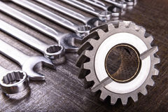 Gear wheel and wrenches Royalty Free Stock Image