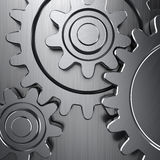 Gear wheels. On metal surface Royalty Free Stock Photography
