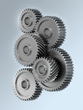 Gear wheels. Several gear wheels symbolizing accuracy over light gradient background Stock Photos