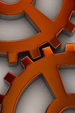 Gear wheels. Interlocking gear wheels in orange over white background Royalty Free Stock Image