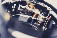 Gear wheels closeup - camera technology macro - mechanical detai Royalty Free Stock Images