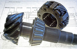 Gear wheels on the drawing. Two steel gear wheels on the drawing Stock Photo