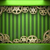 Gear wheels on green background Stock Photo