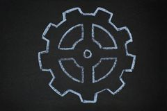 Gear wheels illustration on blackboard Stock Photo