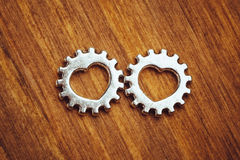 Gear wheels with heart symbol Royalty Free Stock Photos