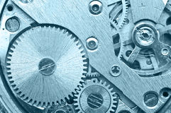 Gear wheels inside clock. Concept Teamwork. Macro Stock Image