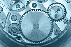Gear wheels inside clock. Concept Teamwork. Macro Royalty Free Stock Image