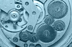 Gear wheels inside clock. Concept Teamwork. Macro Royalty Free Stock Photography