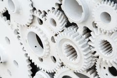 White engine gear wheels like industrial background stock photos