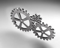 Gear wheels from metal on grey background. Highly detail render. Gear wheels from silver metal on grey background. Highly detail render Stock Photo