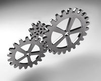 Gear wheels from metal on grey background. Highly detail render. Gear wheels from silver metal on grey background. Highly detail render Royalty Free Stock Image