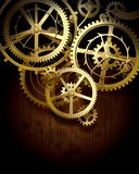 Gear wheels. Raster version of vector background with golden gear wheels on dark dirty surface with blots. There is in addition a vector format (EPS 10 Royalty Free Stock Photo
