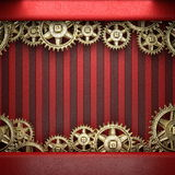 Gear wheels on red background Stock Photos
