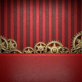 Gear wheels on red background Stock Photography