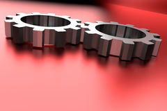 Gear wheels on red shining background Royalty Free Stock Images