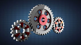 Gear wheels rotate on blue background Stock Photos