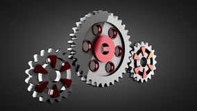 Gear wheels rotate on gray background Royalty Free Stock Photo