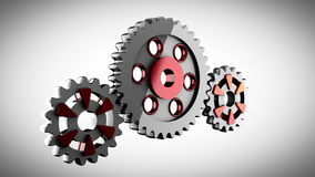 Gear wheels rotate on gray background Royalty Free Stock Photos