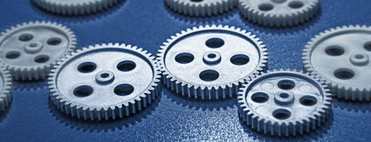 Gear wheels in a row Royalty Free Stock Images
