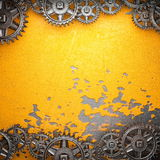 Gear wheels on steel background Stock Photos