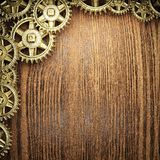 Gear wheels on wood. En background Royalty Free Stock Images