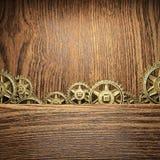 Gear wheels on wood. En background Stock Image