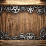 Gear wheels on wood Stock Photo