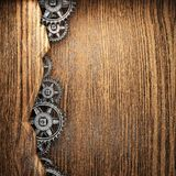 Gear wheels on wood. En background Royalty Free Stock Photography
