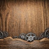 Gear wheels on wood Royalty Free Stock Image