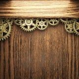 Gear wheels on wood Stock Photos