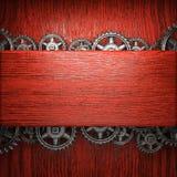 Gear wheels on wood. En background Stock Images
