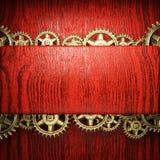 Gear wheels on wood. En background Royalty Free Stock Image