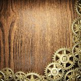 Gear wheels on wood. En background Royalty Free Stock Photos