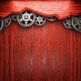 Gear wheels on wood. En background Stock Photo