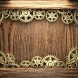Gear wheels on wood. En background Stock Photos
