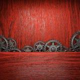 Gear wheels on wood. En background Royalty Free Stock Photo