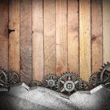 Gear wheels on wood. En background made in 3D Royalty Free Stock Photography