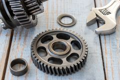 Gear wheels on a wooden table Stock Images