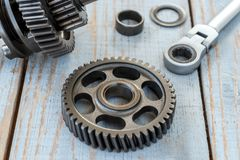 Gear wheels on a wooden table Stock Photo